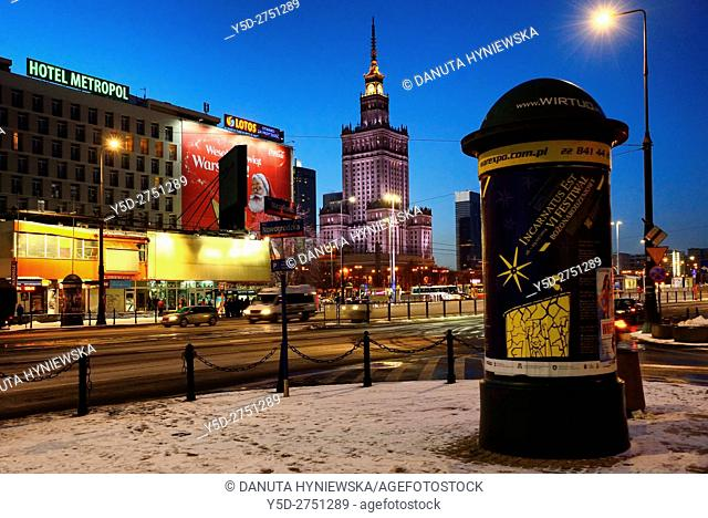 Warsaw center at night, in background Palace of Culture and Science, crossroad of Marszalkowska street and Nowogrodzka street, Srodmiescie district, winter