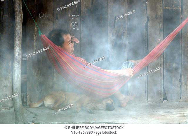Vietnam, Mekong delta, Soc Trang, man sleeping in a hammack