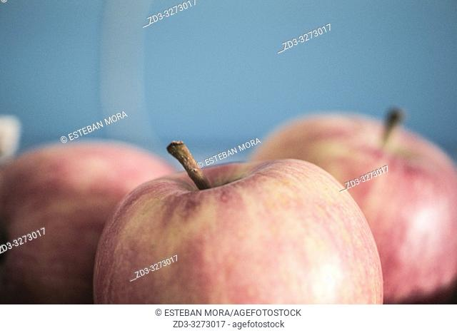 Red Apples on blue background