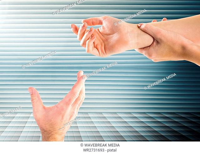 Composite image of Hands retaining against striped background