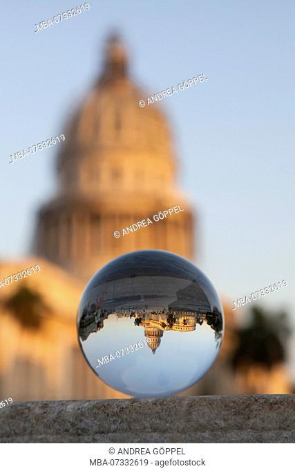 Caribbean, Cuba, Havana, La Habana, National Capitol Building reflected in glass ball