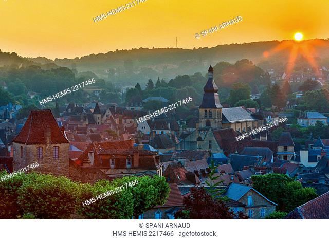 France, Dordogne, Dordogne Valley, Black Perigord, Sarlat la Caneda, panoramic view of a cityscape representing the historic city center of Sarlat at sunset