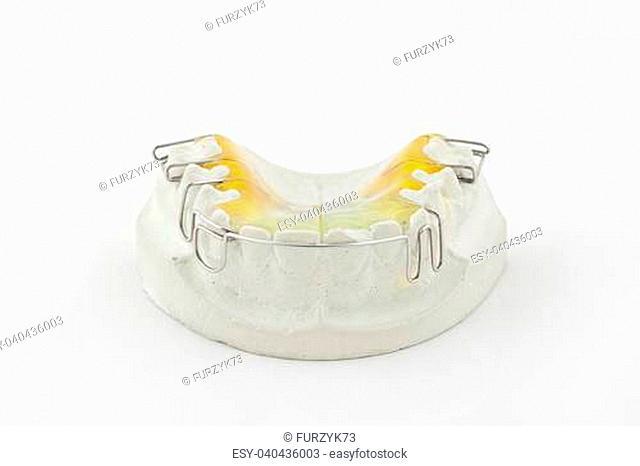 Dental plate on white background