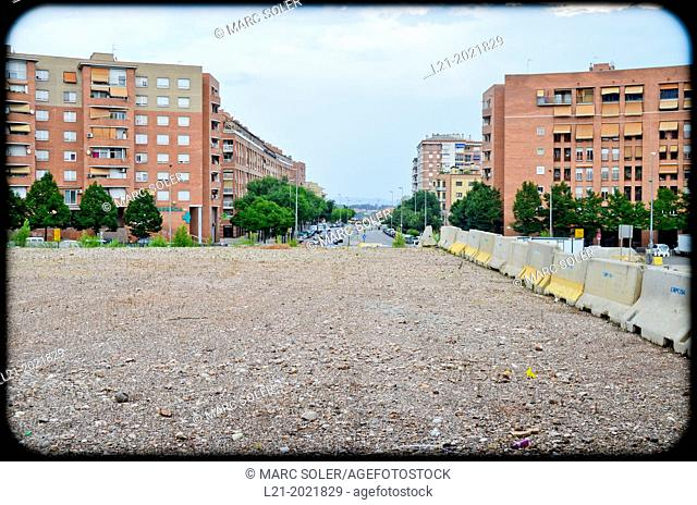 Land with nothing, without building. In the background, apartment houses and a street. Sabadell, Barcelona province, Catalonia, Spain