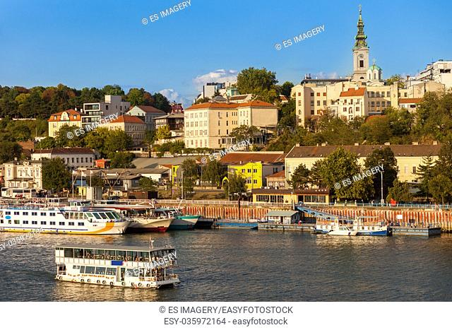 A tour boat on the Sava River motors along the Belgrade waterfront
