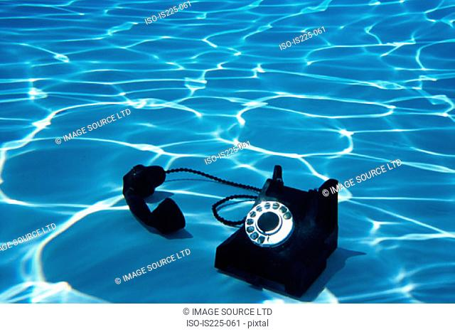 A telephone on the bottom of a swimming pool