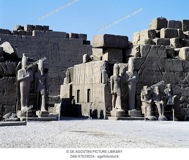 Repository pits (favissa) Courtyard, South Propylaea and colossal statues, dating from the reign of Thutmose III, Karnak temple complex (Unesco World Heritage...