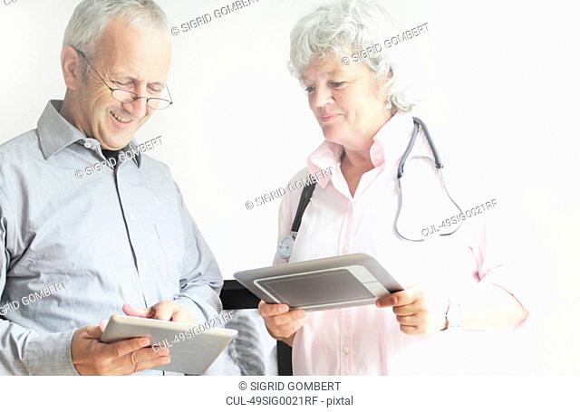 Doctors using tablet computers