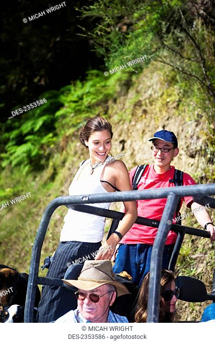 Travelers explore the grounds on a buggy tour at Blue Duck lodge, a working New Zealand farm located in the Whanganui National park; Whakahoro, New Zealand