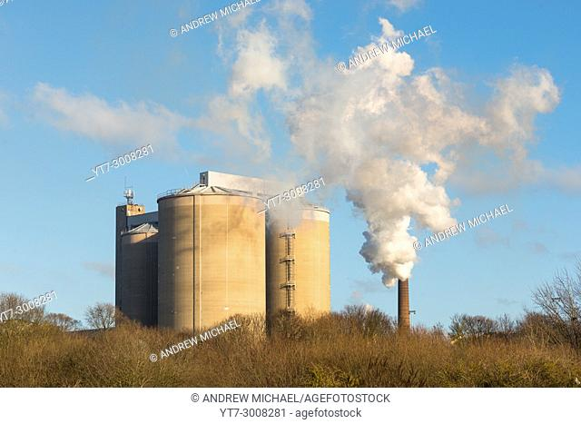Smoke bellowing out of a chimney at British Sugar factory at Bury St Edmunds, Suffolk, East Anglia, England, UK