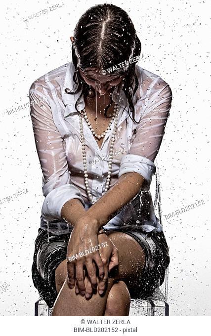 Rain falling on Caucasian businesswoman