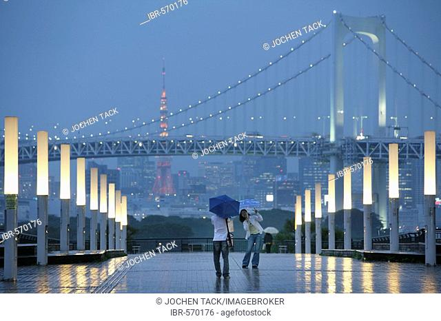 View from Odaiba over Bay with Rainbow-Bridge to mainland Odaiba is an artificial island in Bay conected to the mainland by Rainbow-Bridge Modern district with...