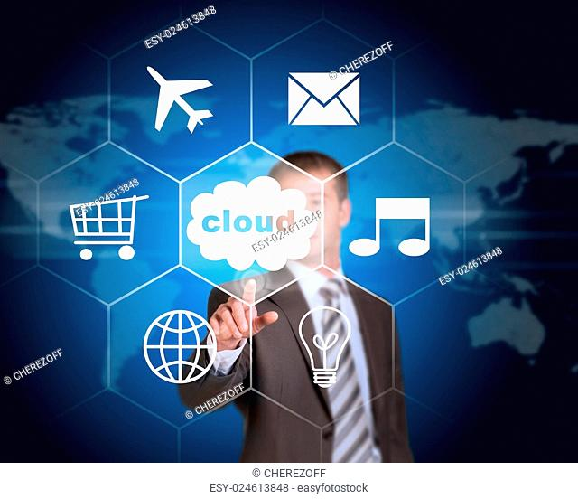 Business man pointing her finger at cloud with icons. Technology concept. World map as backdrop