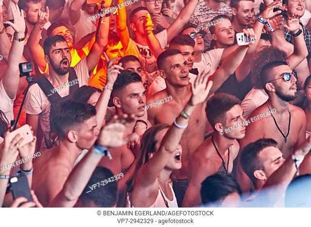 party people cheering to Hardwell B2B Afrojack, enjoying edm dance music at music festival Starbeach, beach flirt dress in white party, on 17
