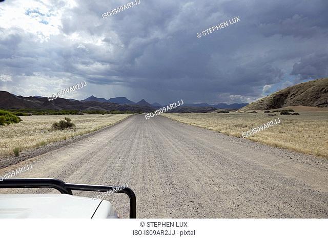 Off road vehicle on road, focus on road, Swakopmund, Erongo, Namibia