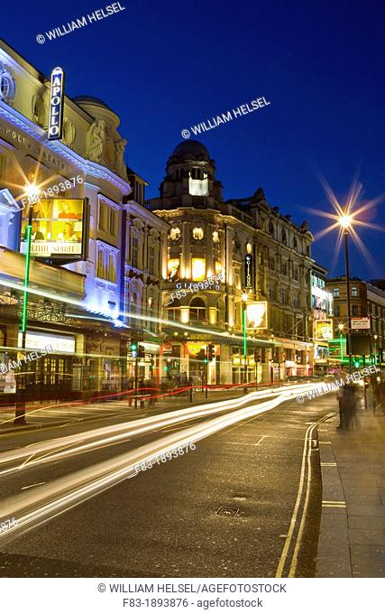 Shaftesbury Avenue theatre district, West End, London, England, with car light streaks, dusk