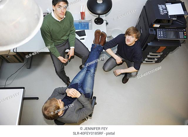 Overhead view of businessmen in office