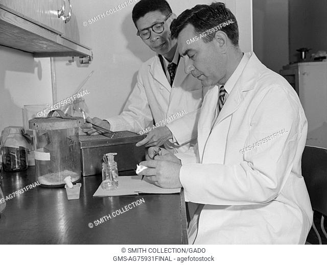 Dr. Li and Dr. Shaffer are conducting polio research in Montgomery, Alabama during a 1953 study. Image courtesy CDC