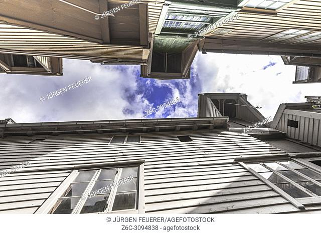 Old Hanseatic buildings of Bryggen in Bergen, Norway, inner view, svensgardens passage with cranes