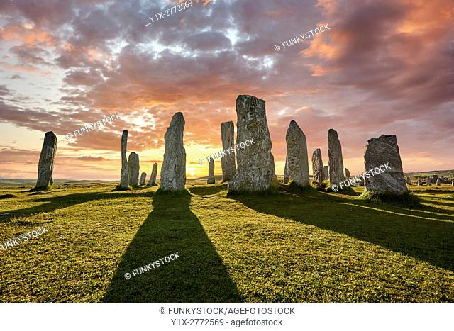 Calanais Standing Stones central stone circle, at sunset, erected between 2900-2600BC measuring 11 metres wide. At the centre of the ring stands a huge monolith...