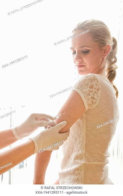 Woman receiving vaccine
