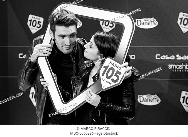 The singers Deborah Iurato and Giovanni Caccamo posing with the Radio 105 sign at the 66th Sanremo Music Festival. Sanremo, Italy. February 2016