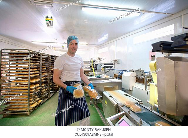 Baker on bread packing production line, portrait