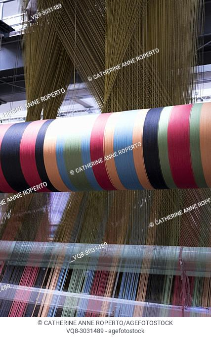 Criss cross and parallel multi coloured threads combining on an industrial jacquard fabric loom, La Manufacture de Roubaix, France
