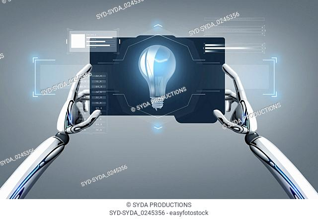 robot hands with light bulb on tablet pc