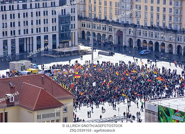 Dresden, Germany - April 06, 2015: The infamous PEGIDA organisation manifest their opinion when havin a meeting on April 06, 2015, on Altmarkt Square, Dresden