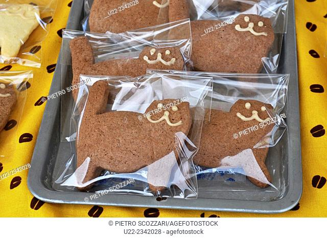 Naha, Okinawa, Japan: cat-shaped cookies sold during a charity market to help stray animals