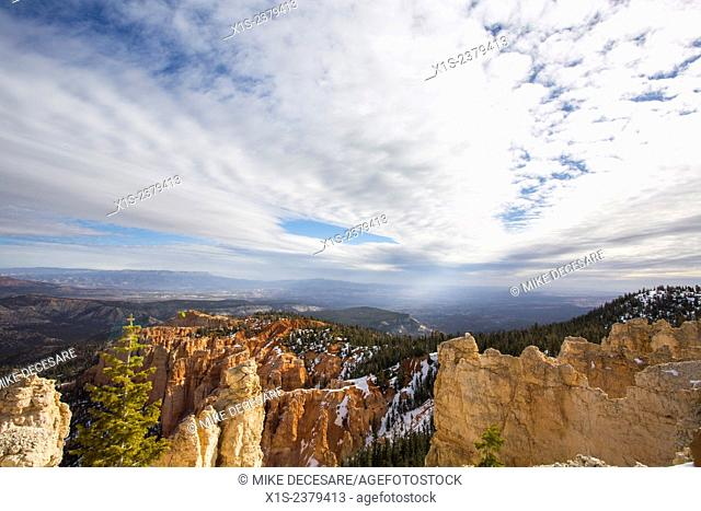 Streams of clouds receding into the distance draw the viewer into and through Bryce Canyon