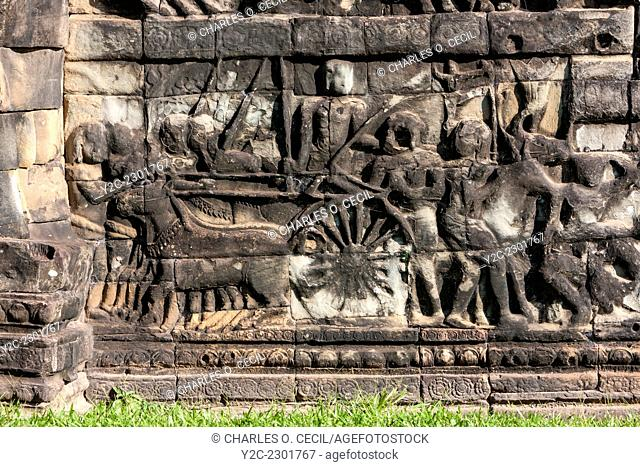 Cambodia, Angkor Thom. Horse-drawn Cart and Soldiers going into Battle