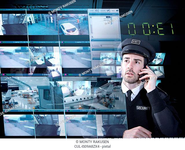 Security guard monitoring camera visuals on interactive screen