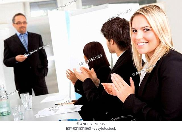 Businesswoman at presentation applauding