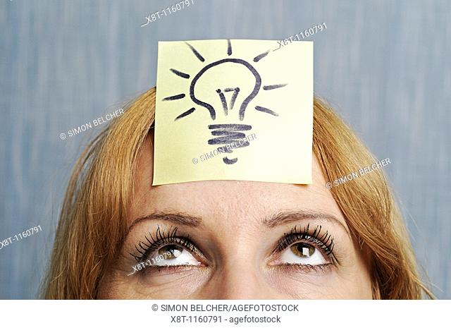 Ideas, Woman with a Drawing of a Lightbulb on Her Head