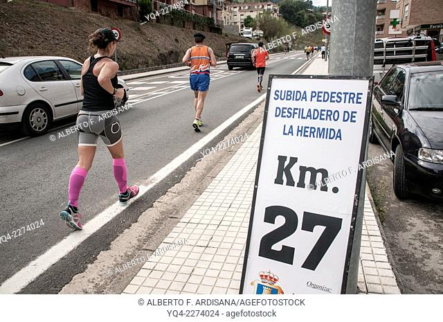 Runners on the run ascent to the Hermida Gorge, Potes. Cantabria, Spain