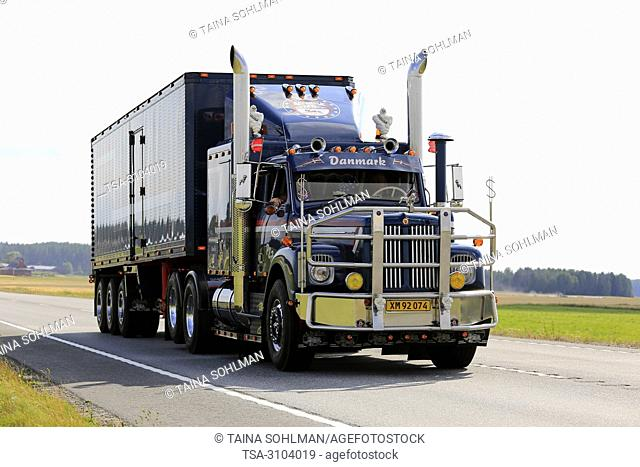IKAALINEN, FINLAND - AUGUST 9, 2018: Customized classic Scania 110 semi trailer with chrome in truck convoy to Power Truck Show 2018, Finland