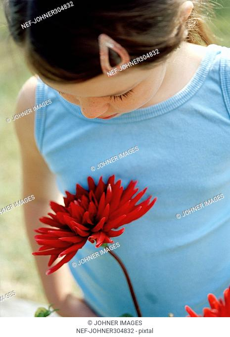 A girl with a red flower
