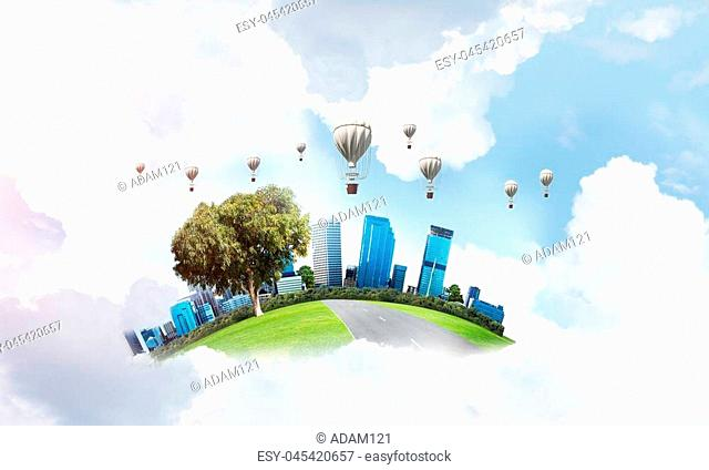 Green flying island with urban view of towers and skyscrapers. Flying aerostates and blue cloudy skyscape on background. 3D rendering