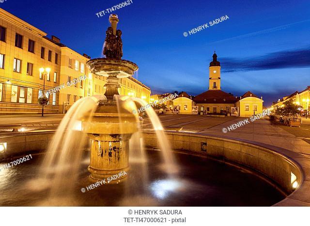 Poland, Podlaskie, Bialostok Fountain on illuminated town square