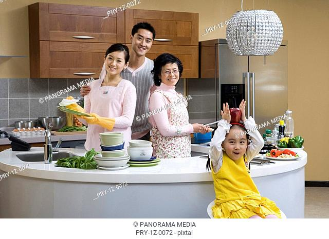 Portrait of a family smiling in kitchen