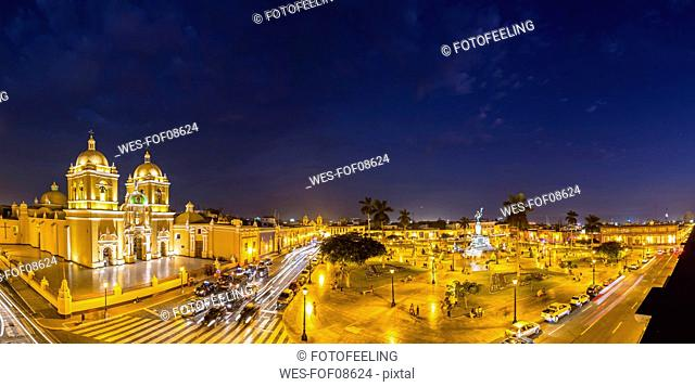 Peru, La Libertad, Trujillo, Plaza de Armas, Cathedral and Liberation Monument at night