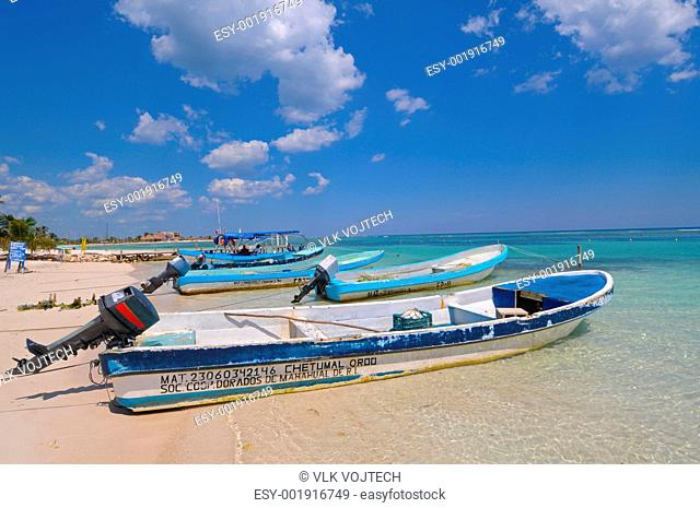 Picture of motorboats on beach of Mahahual in Mexico