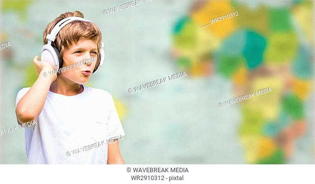 Boy with headphones against blurry map
