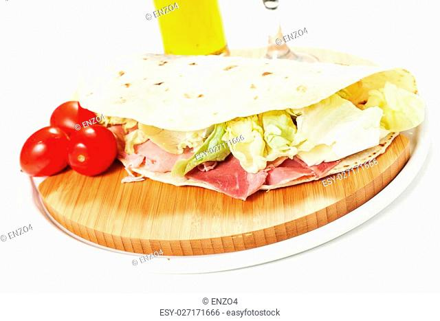 Traditional Italian piadina on the white background