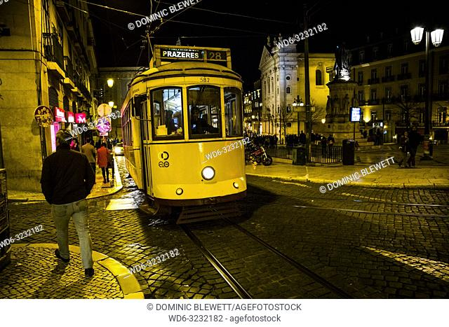 A tram at nighttime in Lisbon, Portugal
