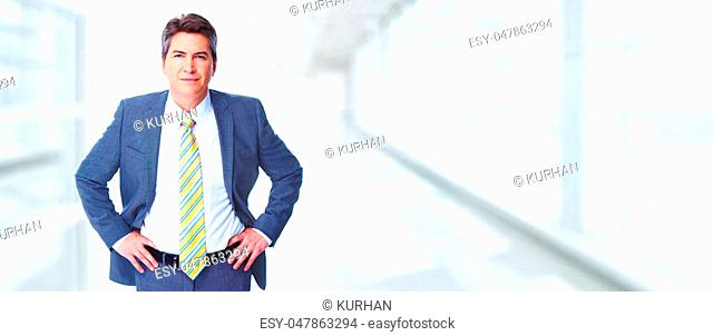 Friendly caucasian businessman over blue abstract background