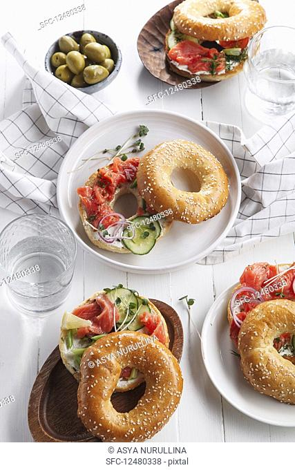 Bagels with salmon fish, cream cheese, cucumber and fresh radish slices