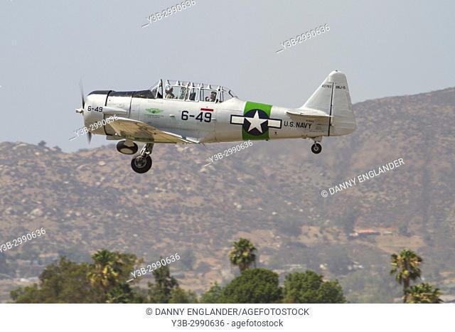 A vintage WW II Navy plane landing at Gillespie Field in El Cajon, California
